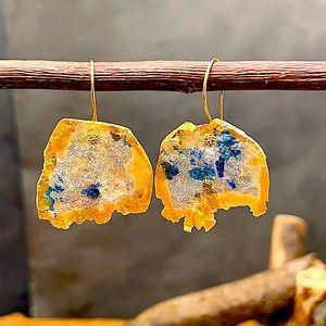 Matana handmade mismatch earrings in gold blue